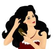 Muchacha que aplica su pelo con brocha Fotos de archivo