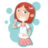 Muchacha que aplica sus dientes con brocha Imagen de archivo