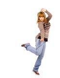 Muchacha que baila al ritmo de la música en auriculares Fotos de archivo libres de regalías