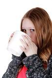 Muchacha que bebe de la taza grande Foto de archivo libre de regalías