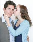 Muchacha que besa al individuo Imagen de archivo libre de regalías