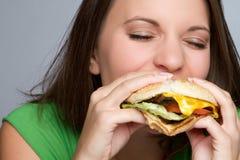 Muchacha que come el alimento Fotografía de archivo libre de regalías