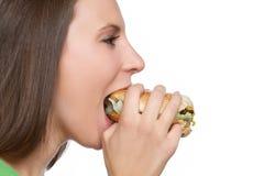 Muchacha que come el alimento Imagen de archivo
