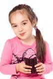 Muchacha que come el chocolate Fotografía de archivo