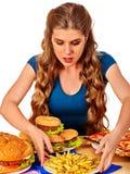 Muchacha que come el emparedado grande Imagen de archivo libre de regalías