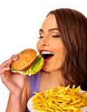 Muchacha que come el emparedado grande Fotografía de archivo