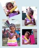Muchacha que come maíz y que sostiene la escoba Imagen de archivo