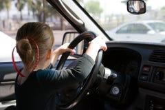 Muchacha que conduce el automóvil Imagen de archivo libre de regalías