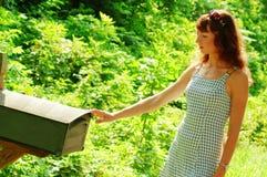 Muchacha que controla el correo Imagen de archivo libre de regalías