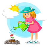 Muchacha que cultiva un huerto Foto de archivo libre de regalías