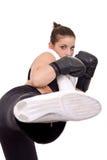 Muchacha que da kickboxing golpeado Imagen de archivo libre de regalías