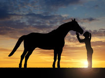 muchacha que da un caballo del beso Imagen de archivo