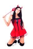 Muchacha que desgasta un imp del traje de víspera de Todos los Santos Imagenes de archivo