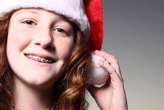 Muchacha que desgasta un sombrero de Santa Imagen de archivo