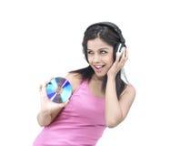 Muchacha que disfruta de música Fotografía de archivo libre de regalías