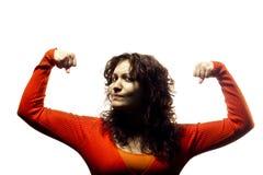 Muchacha que dobla sus músculos Imagenes de archivo
