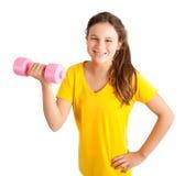 muchacha que ejercita con pesa de gimnasia Imágenes de archivo libres de regalías