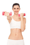 Muchacha que ejercita con pesas de gimnasia Fotos de archivo
