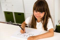 Muchacha que escribe el alfabeto de ABC Fotografía de archivo libre de regalías