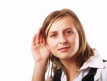 Muchacha que escucha Imágenes de archivo libres de regalías