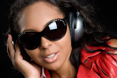 Muchacha que escucha de la música Imágenes de archivo libres de regalías