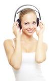 Muchacha que escucha la música en blanco Fotografía de archivo libre de regalías