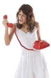 Muchacha que grita en el teléfono Foto de archivo libre de regalías
