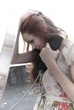 Muchacha que habla en el teléfono Fotografía de archivo