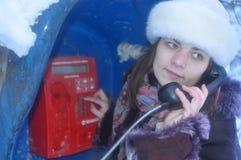 Muchacha que habla en el teléfono Imágenes de archivo libres de regalías