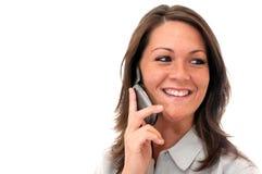 Muchacha que habla en el teléfono celular aislado Fotos de archivo