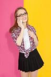 Muchacha que habla en el teléfono móvil Foto de archivo libre de regalías