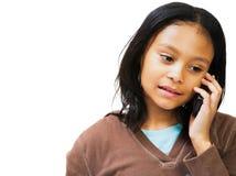 Muchacha que habla en el teléfono móvil Fotografía de archivo libre de regalías