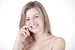 Muchacha que habla en un teléfono celular Fotografía de archivo libre de regalías