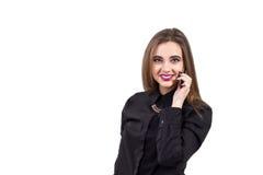 Muchacha que habla en un teléfono móvil Retrato de una muchacha Imagen de archivo libre de regalías