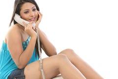 Muchacha que habla sobre el teléfono Imagen de archivo libre de regalías