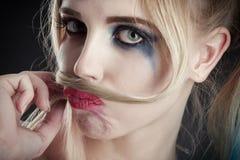 Muchacha que hace el bigote Foto de archivo libre de regalías