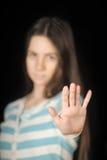 Muchacha que hace gesto de la parada Fotografía de archivo libre de regalías
