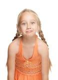 Muchacha que hace la cara divertida Fotos de archivo