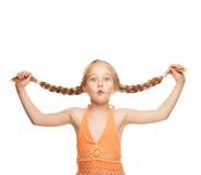 Muchacha que hace la cara divertida Foto de archivo libre de regalías
