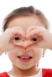 Muchacha que hace la muestra del corazón Imagenes de archivo