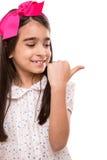 Muchacha que hace los pulgares a la derecha fotografía de archivo libre de regalías