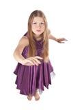 Muchacha que hace un gesto que pide Foto de archivo libre de regalías