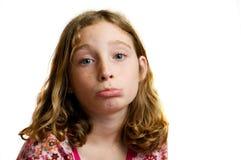Muchacha que hace una cara triste Foto de archivo