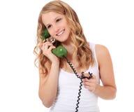 Muchacha que hace una llamada de teléfono Fotos de archivo