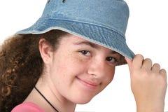 Muchacha que inclina el sombrero Imagen de archivo