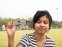 Muchacha que intenta sus vidrios Fotografía de archivo libre de regalías