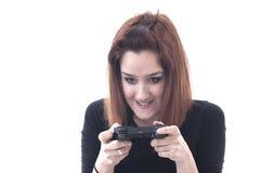 Muchacha que juega adicta con el regulador del juego Imagenes de archivo