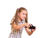 Muchacha que juega al juego. Imagenes de archivo
