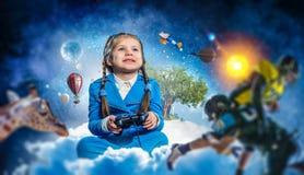 Muchacha que juega al juego video Técnicas mixtas Fotografía de archivo libre de regalías