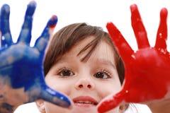 Muchacha que juega con colores Fotografía de archivo